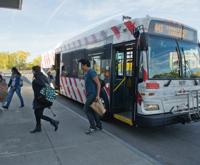 Students exit the Connective Corridor bus at the Nancy Cantor Warehouse downtown.