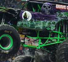 Grave digger monster truck with green accents and skulls