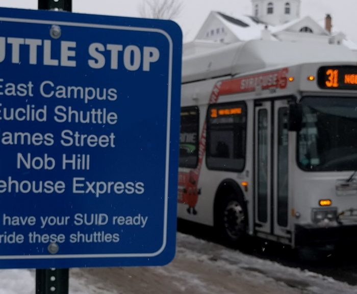 Shuttle stop sign with Birnie Bus in the background