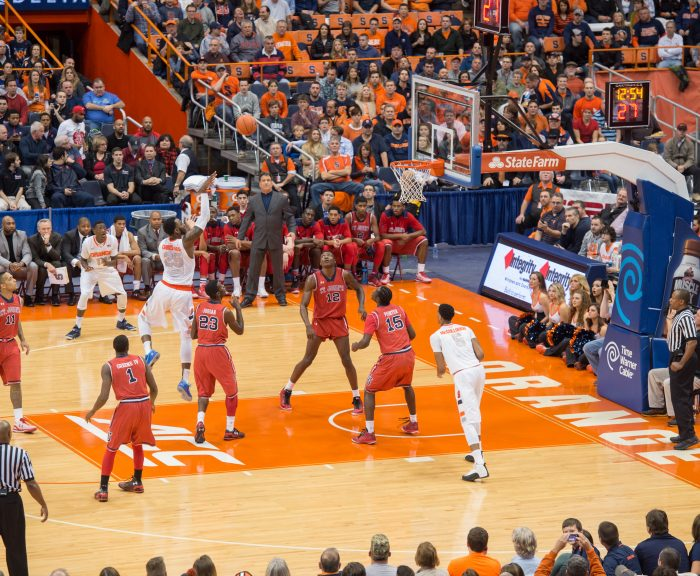 SU Men's basketball team playing on the court in the Carrier Dome.