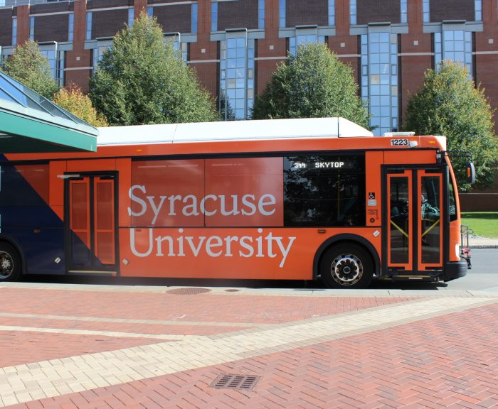 Picture of an orange SU bus at College Place.