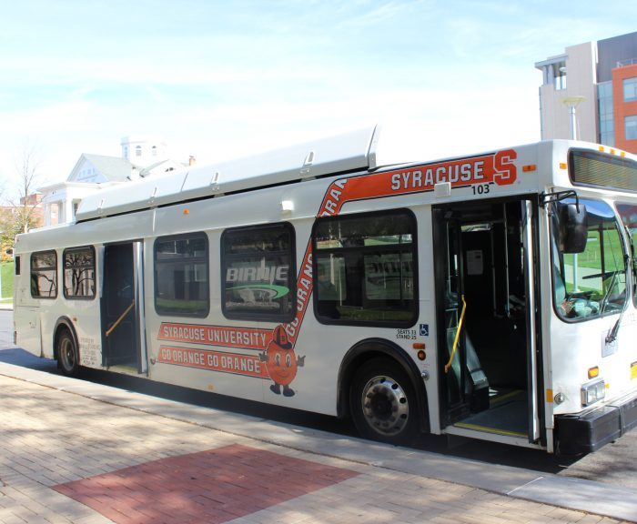White Birnie Bus with Syracuse University and Go Orange decals on the side with Otto the Orange