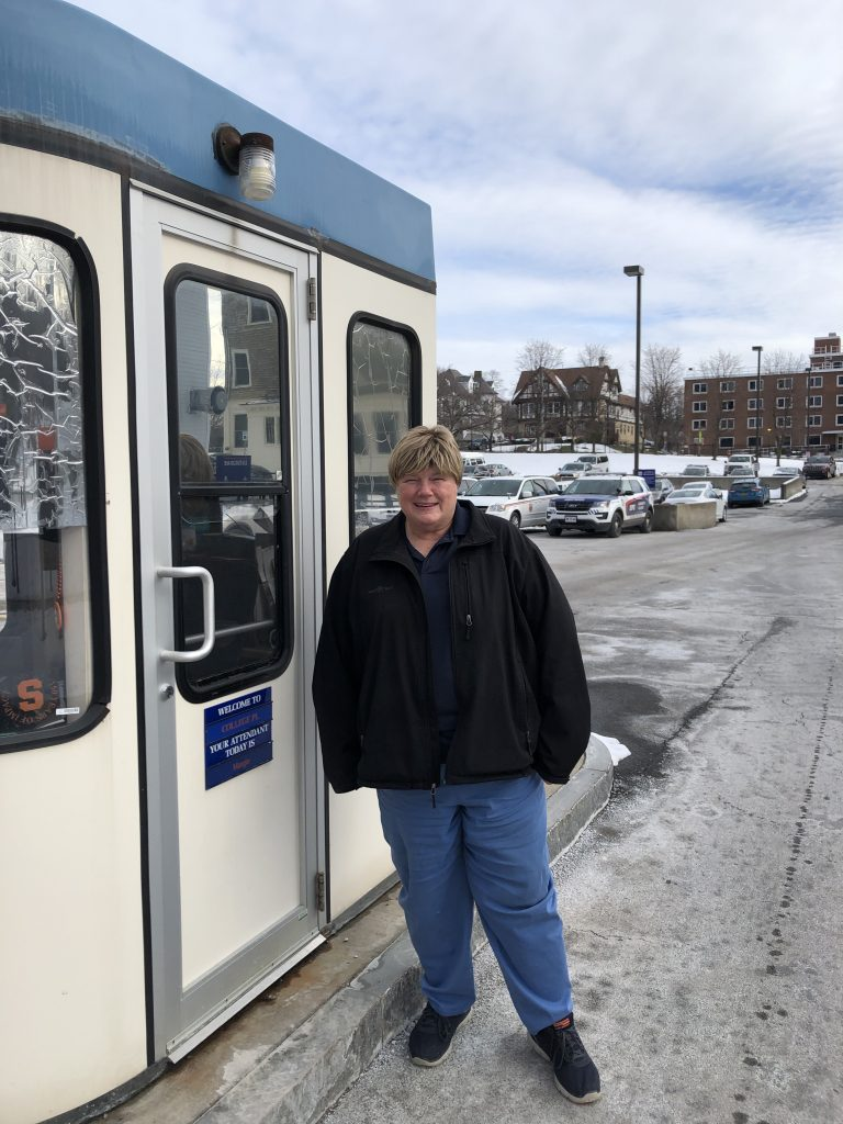 Woman Standing Outside of Parking Booth
