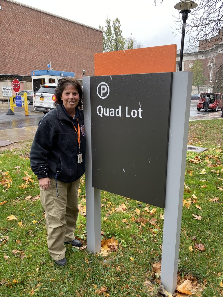 Woman Standing Next To Quad Lot Sign