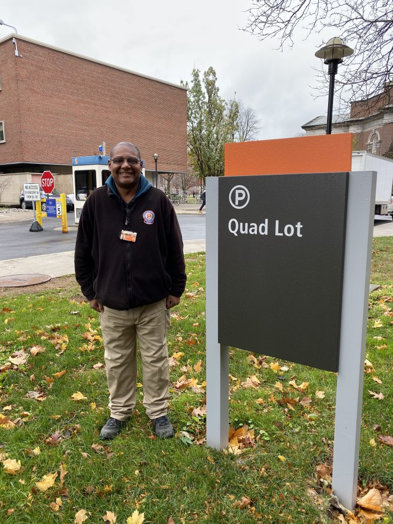 Man Standing Next To Quad Lot Sign
